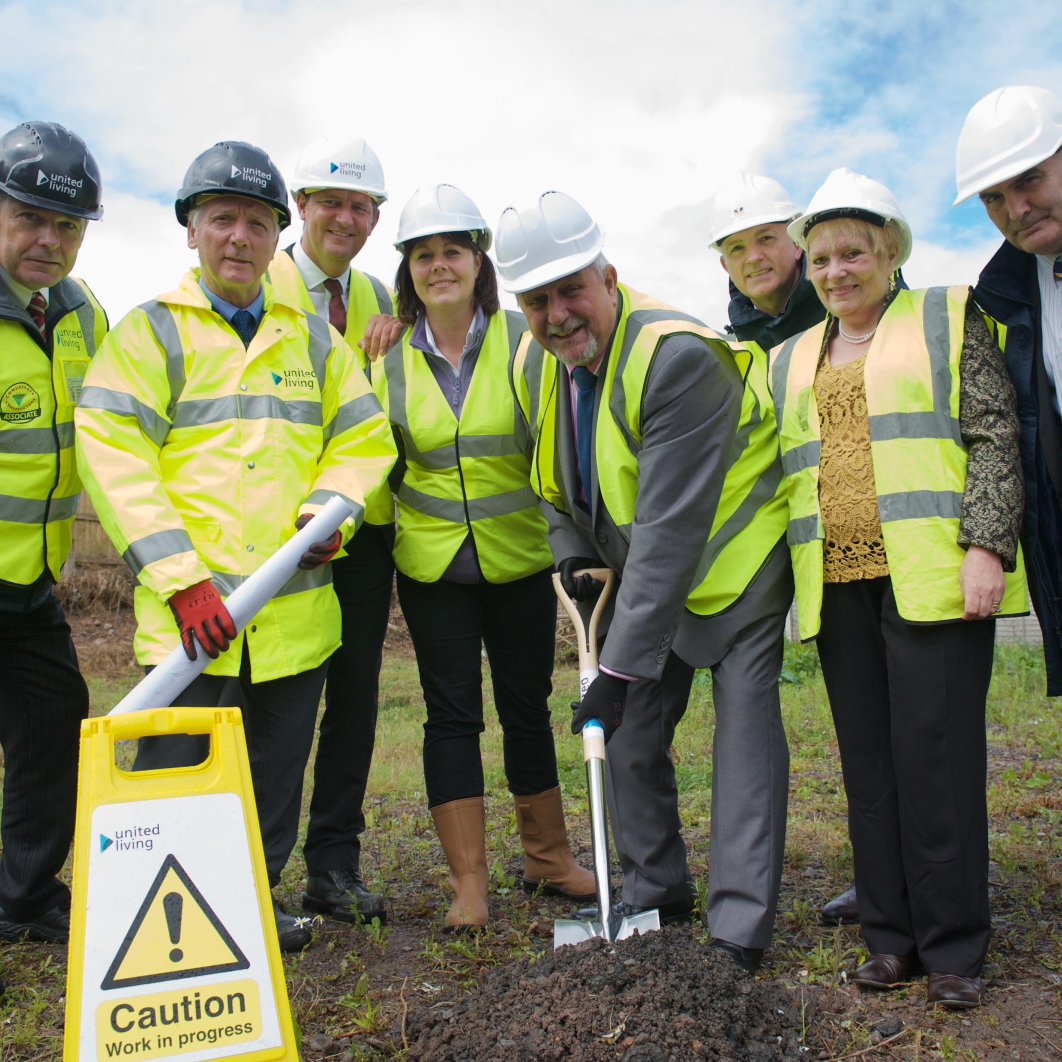 Photo showing Councillor Peter Bilson starts work at Sunset Place alongside (left to right)  Tony Tyson-Phillips and Stefan Czajkowski, both from United Living,  Steve North of Wolverhampton Homes, Karen Beasley, from the  City of Wolverhampton Council's Housing Team, and Shaun Aldis,  Sue Roberts and Wilson Severn, all from Wolverhampton Homes.